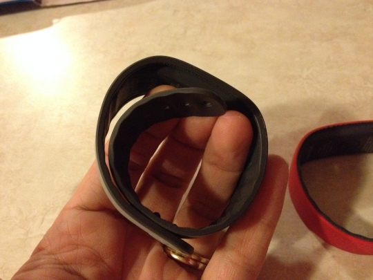 Band shown attached to the first two holes on the lighter gray part.